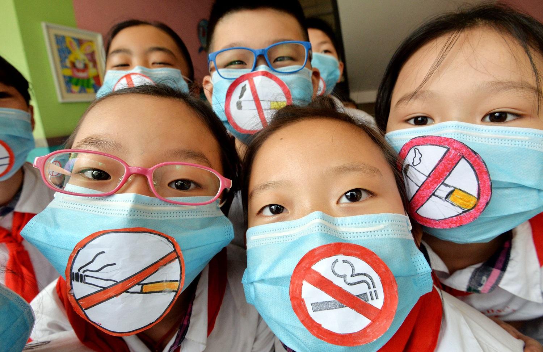 Estudantes chineses protestam contra o fumo nas escolas do país. Hao qunying / Imaginechina