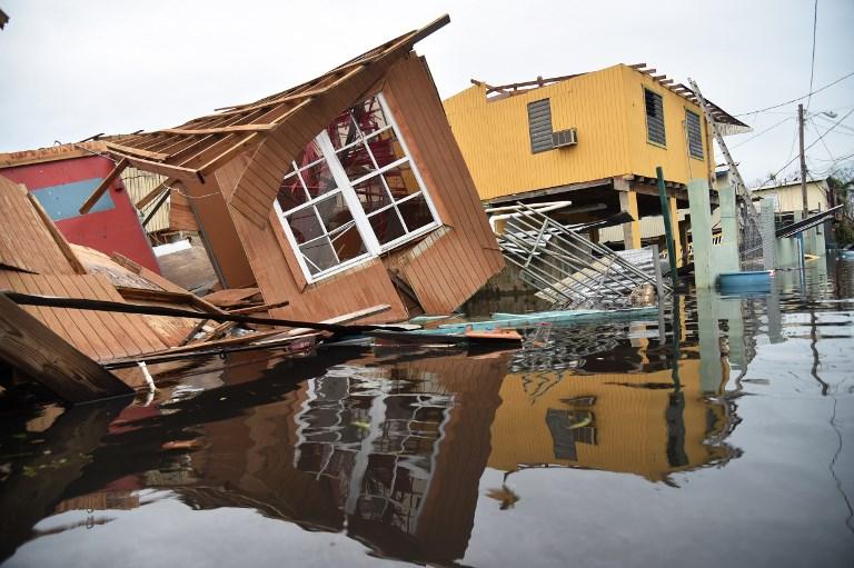 Casas desabadas pelo furacão Maria, em Porto Rico/ Foto: Hector Retamal/AFP