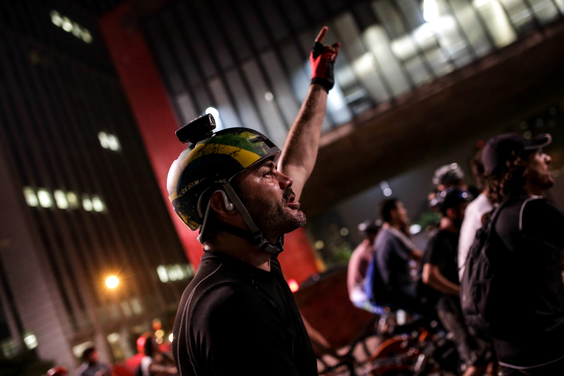A cyclist shouts during a protest that gathered thousands of cyclists in favor of the construction of bike lanes on Paulista Avenue in Sao Paulo, Brazil on Friday, March 27, 2015. The protest, which won support from by cyclists from various cities in the world, is in response to the attempt of a city's attorney to stop the implementation of bike lanes by the mayor of Sao Paulo. (Photo by Tiago Mazza Chiaravalloti/NurPhoto)