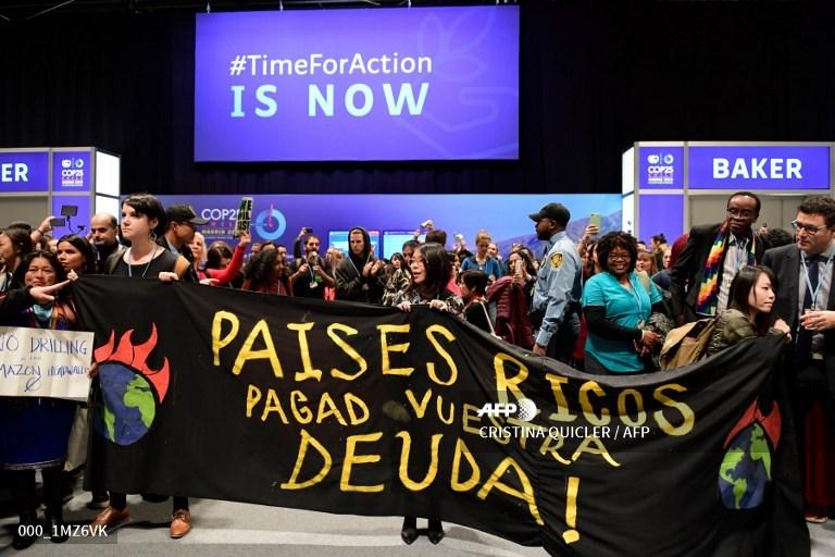 Protesto na COP25. Foto Cristina de Quicler/ AFP