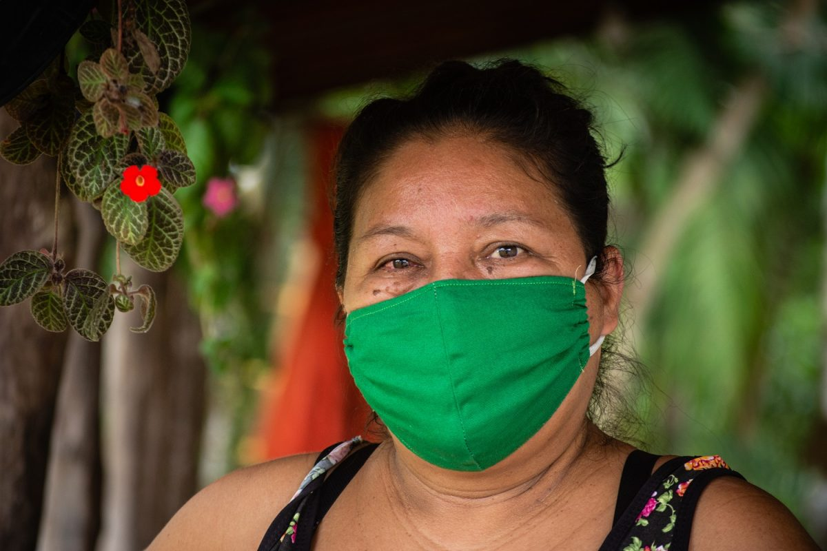 Sandra Amorim wears a green cloth face mask.